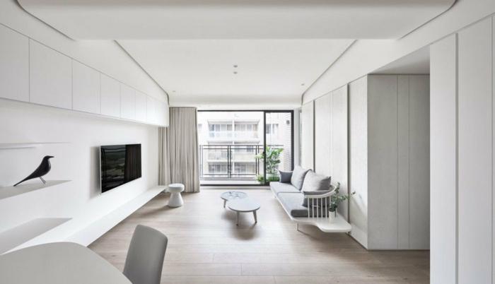 grande salón en blanco con bonita decoración, muebles de salon modernos de diseño sencillo y líneas limpias