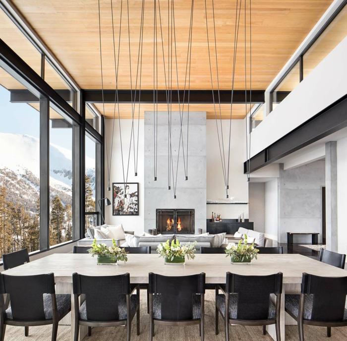 salón comedor de encanto decorado en estilo moderno, como decorar un salon comedor, lámparas colgantes modernas, grande mesa de madera en forma rectangular