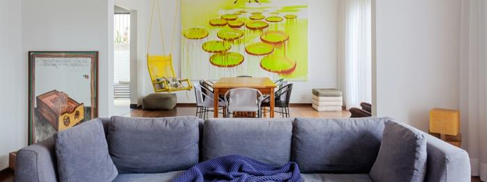 piso abierto con grande comedor, punto focal en la pintura en la pared, cómo decorar un salón comedor paso a paso