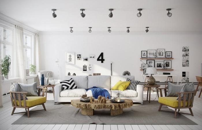grande salón en blanco y gris con objetos decorativos en amarillo y mesa de diseño original, salon gris y blanco con mucha decoración