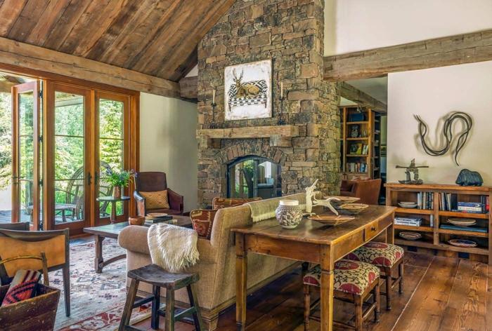 decoracion de salones en estilo rústico, espacio abierto con muebles de madera y pared de ladrillo