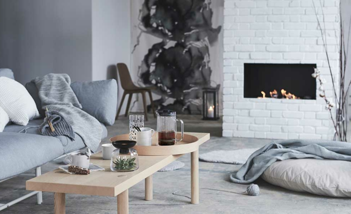 rincón acogedor de un salón moderno decorado en blanco y gris, decoracion de salones minimalista