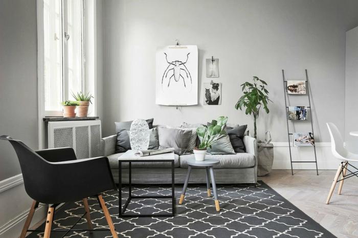 pequeño salon decorado en tonos oscuros, paredes en gris ceniza y muebles en blanco y negro, decoracion salones modernos