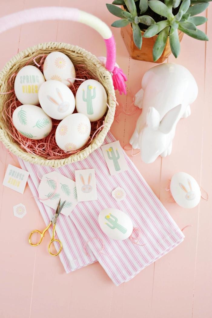 bonita decoración para la primavera, manualidades huevos de pascua fáciles de hacer, dibujos en colores pastel y decoración de plantas verdes