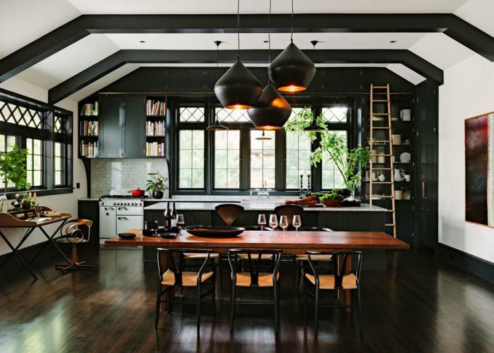 decoracion salones abiertos a la cocina y el comedor, espacio con interesantes elementos arquitectónicos, cocina en negro y comedor moderno