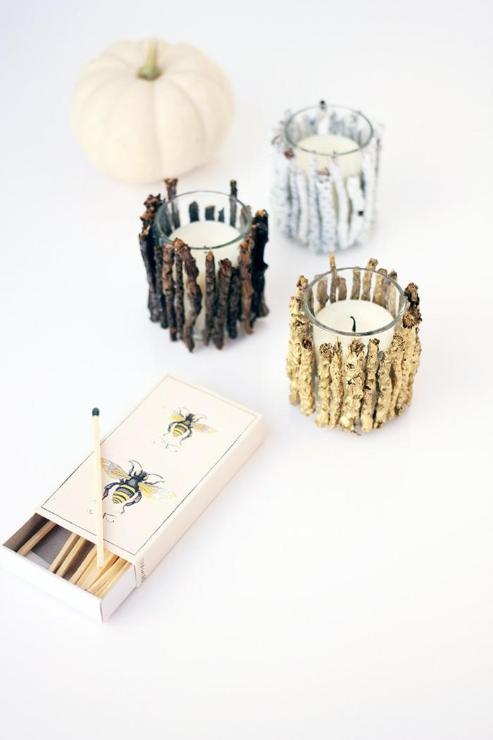 pequeños tarros decorados con palos de madera, velas decorativas originales DIY, manualidades con botes