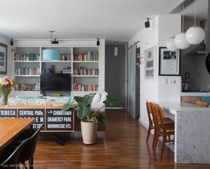 precioso espacio abierto decorado de manera original, cocina con isla y decoración con flores y plantas verdes, ideas ikea decoracion