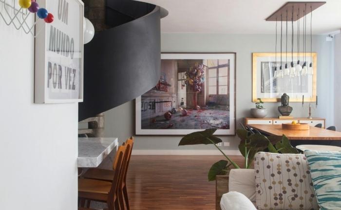 decoracion salon pequeño abierto al comedor, preciosos cuadros decorativos y decoración con plantas verdes