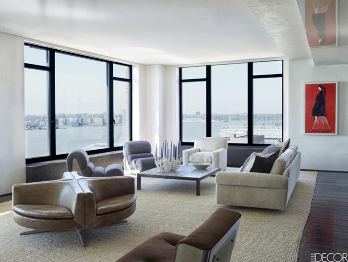 grande salón decorado en blanco, gris y beige con bonita vista al mar, ideas decoracion salon en estilo minimalista