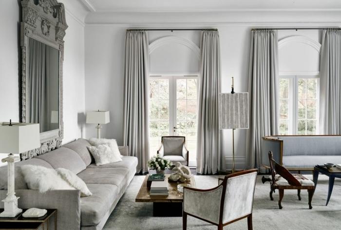 diseño de encanto en estilo vintage, salon gris y blanco con muebles de época y cortinas modernas en gris plomo