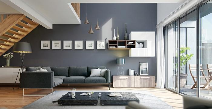 espacio abierto decorado en estilo contemporáneo con paredes color pizarra, decoracion salon comedor con muebles de diseño