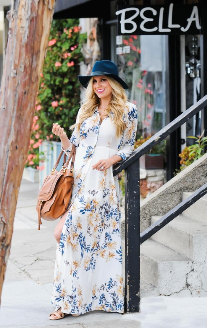 propuesta sobre vestidos largos estampados, precioso vestido de algodón en blanco con estampado de flores en azul y beige, sombrero en azul y pelo suelto ondulado