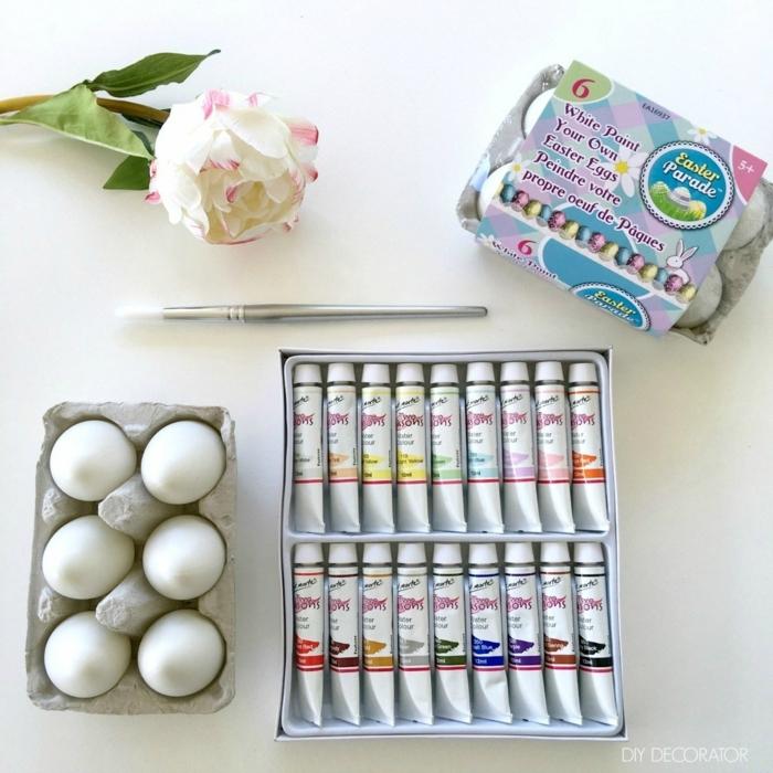 materiales necesarios para decorar los huevos, huevos de pascua para colorear, pintura acrílica en muchos colores, pincel y decoración de flores