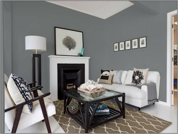 decoracion de interiores con paredes grises, objetos decorativos modernos, muebles en blanco y alfombra en beige
