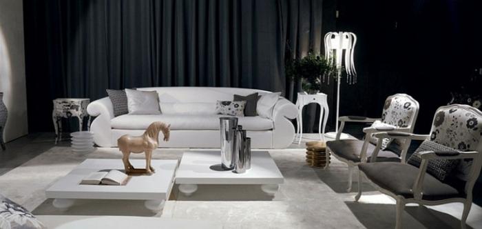 salón con paredes grises oscuros y cortinas negras, espacio decorado en estilo moderno y tonos oscuros con muebles en blanco
