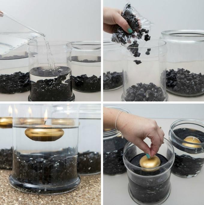 decoracion con tarros decorados llenos de agua y velas flotantes, bonita idea para reciclar los frascos de vidrio que tenemos en casa
