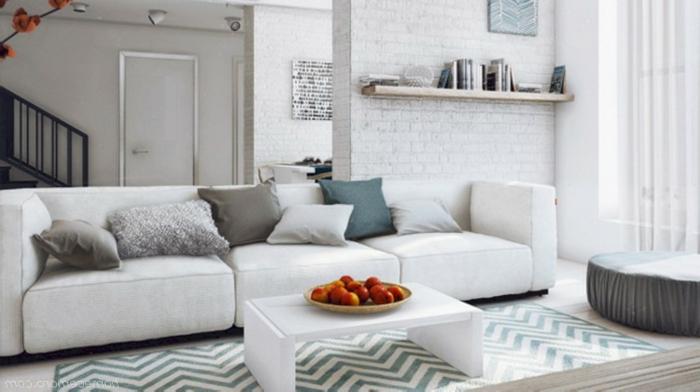 decoración salon comedor moderno, espacio decorado en tonos claros con muebles modernos, pared de ladrillo y cojines decorativos