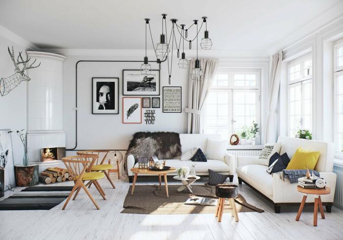 grande salón con mucha decoración, sillas y mesa de madera, decoracion salones contemporáneos, lámpara de diseño original y muchos cuadros decorativos