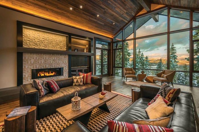 grande espacio con ventanales y bonita vista, decoracion rustica, muebles tapizados de piel negra, salones rusticos de encanto