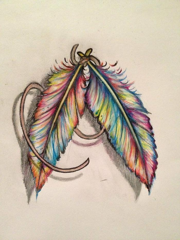 preciosas ideas diseños de tatuajes con plumas, dos plumas pintados en papel en colores del arco iris
