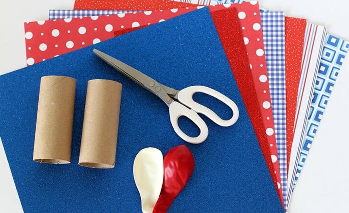 materiales necesarios para decorar tubos de cartón llenos de papel picado, papel de embalaje, rollos de papel higienico, globos, ideas manualidades rollo papel higienico