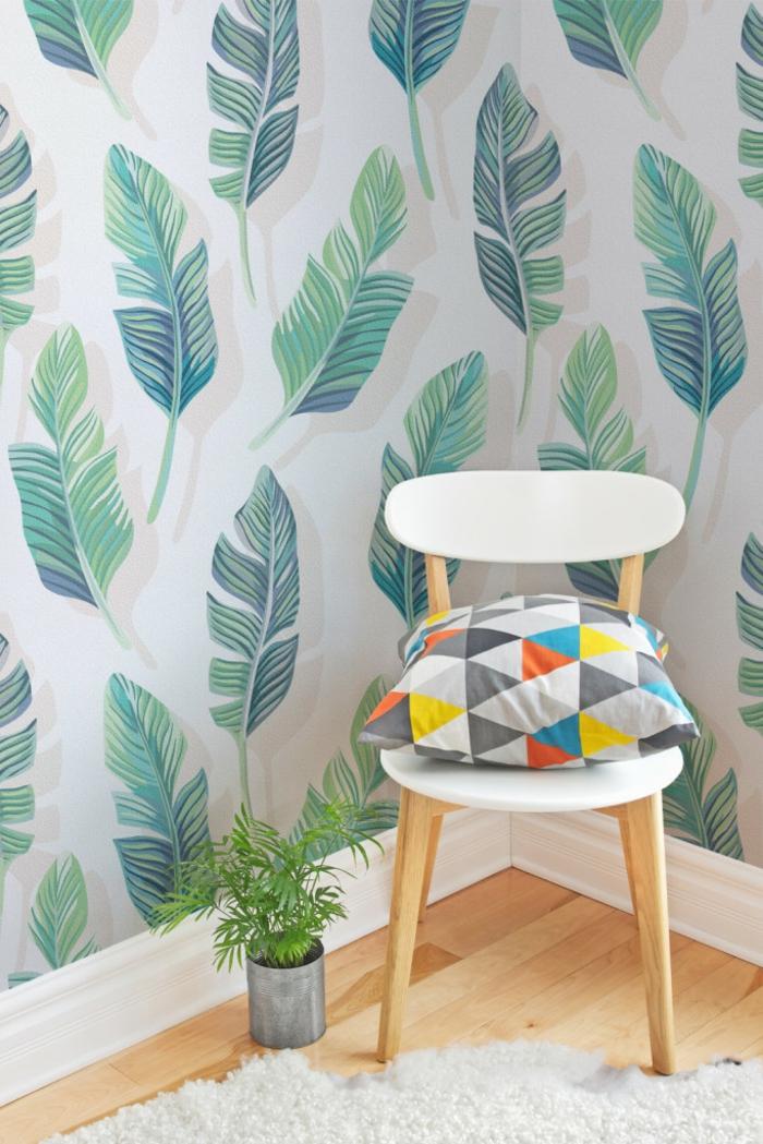 ideas para decorar con papel vinilico, pared con vinillo moderno, dibujo de hojas verdes en fondo blanco
