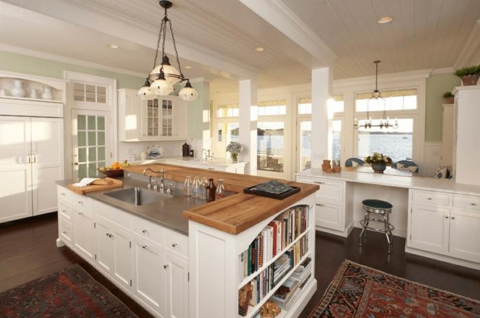 diseño de cocinas modernas con islas originales, lámpara y alfombra vintage y decoración en blanco