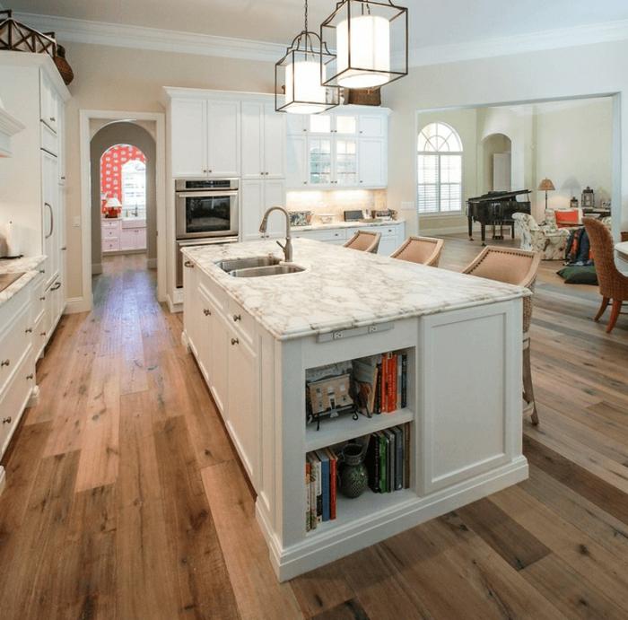 diseño de cocinas modernas decoradas en blanco, espacio abierto decorado en estilo contemporáneo en tonos claros y suelo de parquet