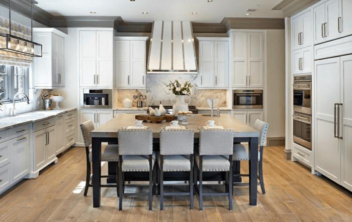 decoracion cocinas en estilo vintage, grande mesa en el centro de la cocina, espacios multifuncionales