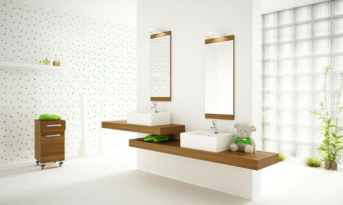 baños blancos con muebles de madera, paredes con azulejos con estampado de puntos verdes