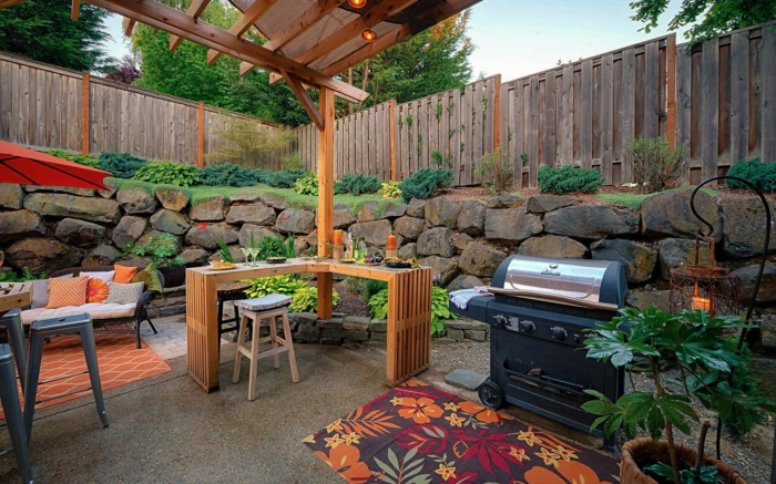 decoracion de jardines, sitio para hacer la barcaboa decorado en colores naturales como el verde y el naranja