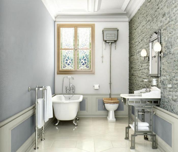 decoracion baños modernos con toque rústico, bañera patas garra, pared de piedra y suelo de baldosas