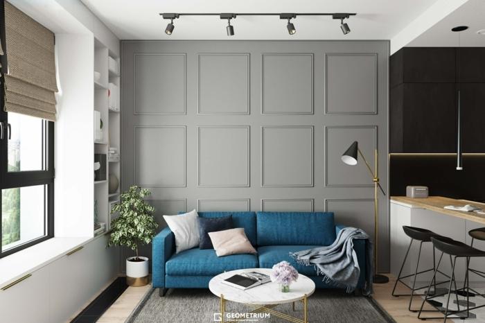 imagenes de salones de color pastel en gris, azul y blanco con mesa redonde pqueña de madera