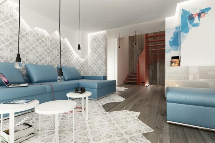 decoracion salon pequeño, sofa de cuero azul con mesas pequeñas redondas en blanco, paredes y sueo con figuras geometricas