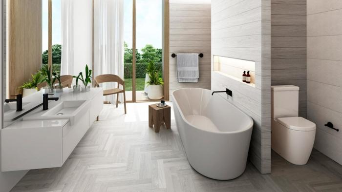 cuartos de baño pequeños decorados en blanco y beige en estilo minimalista, bañera moderna exenta