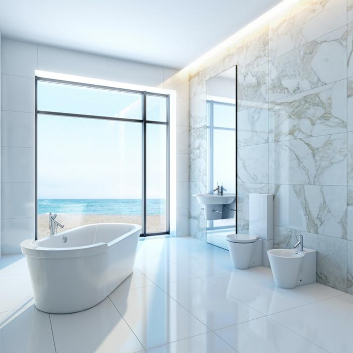 precioso baño decorado en blanco y beige con vista al mar, decoracion baños pequeños ideas