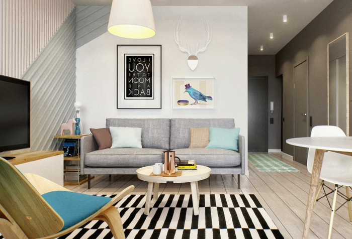 decoracion salon comedor rectangular, alfombra de rectangulos en blanco y negro y sofa en gris claro