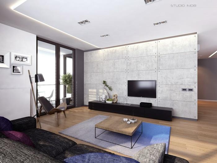 imagenes de salones con pared en el medio de la sala con televisor colgado y ventanas grandes