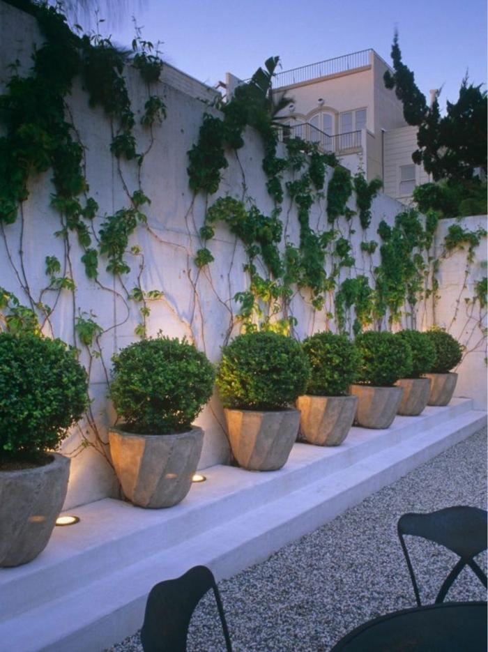 preciosas ideas de decoración de jardines modernos, macetas con arbustos ornamentales en forma oval