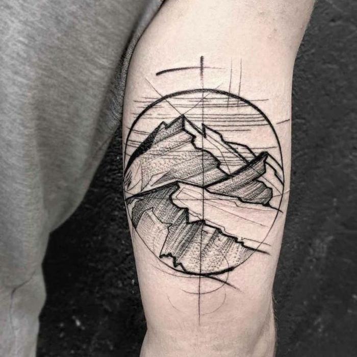 diseños de tatuajes para hombres con significado, dibujo de montañas en un círculo, ideas para tatuajes 2018