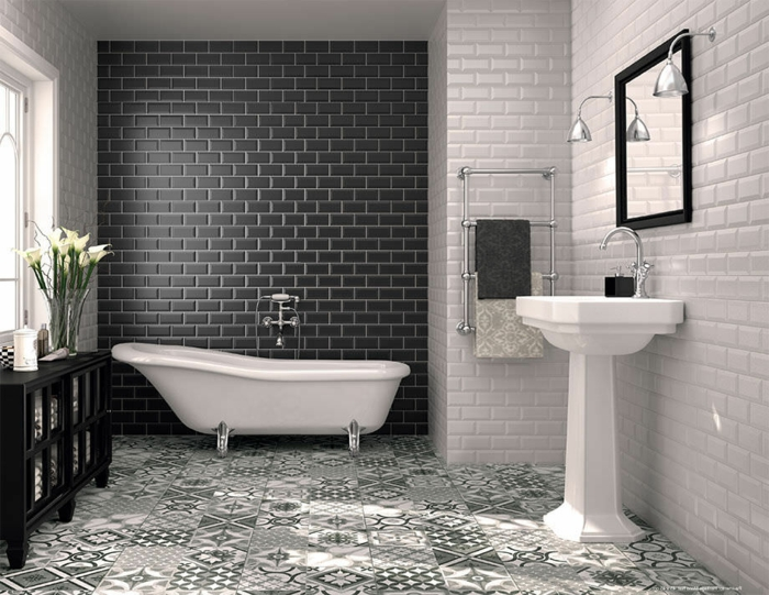 baños blanco y negro de diseño, paredes con azulejos en blanco y negro que imitan ladrillos y suelo con azulejos ornamentados blanco y gris