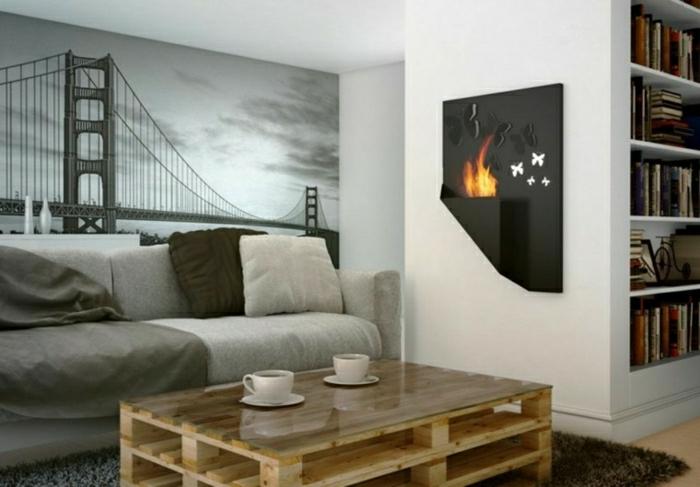 mesa hecha con dos palets sin pintar con un vidrio encima y con dos tazas de té, foto tapete en la pared