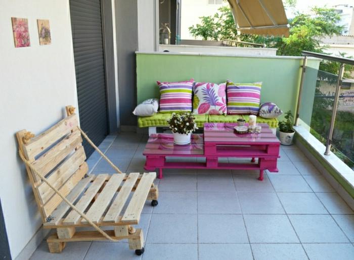 mesa ideal para la terraza de bajo coste hecha con palets y pintada de rosa fuscia de dos niveles