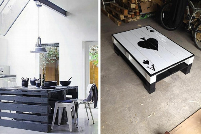 mesa de dos palets pintada de blanco y negro con una carta de AS pintada en la superficie