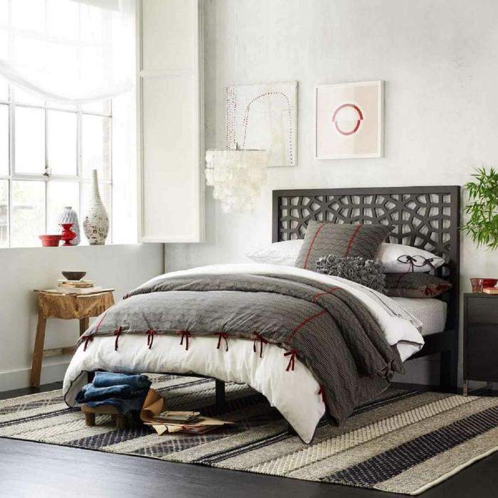 dormitorios matrimonio en estilo bohemio moderno, mesita de madera rústica, paredes en gris claro