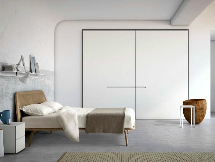 dormitorios matrimonio en estilo minimalista decorado en blanco y gris claro, cama de rattan