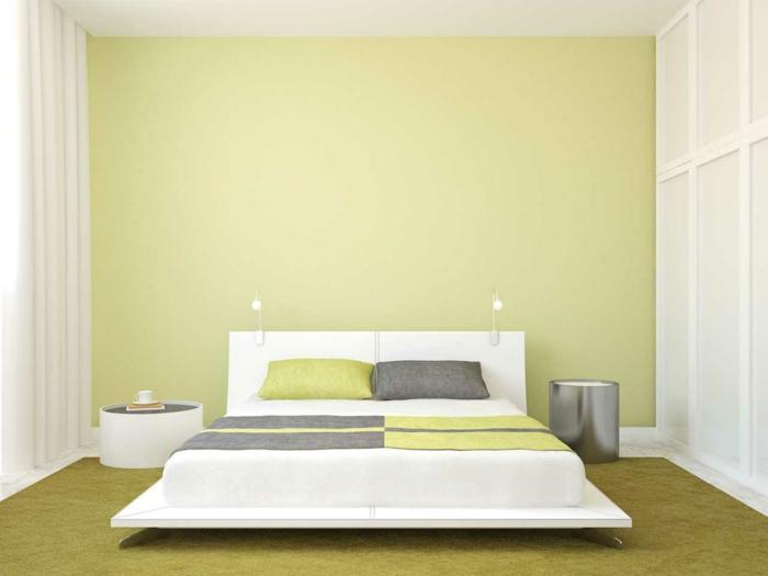 habitacion matrimonial con pared en verde claro con cama blanca con sabanas en verde, gris y blanco