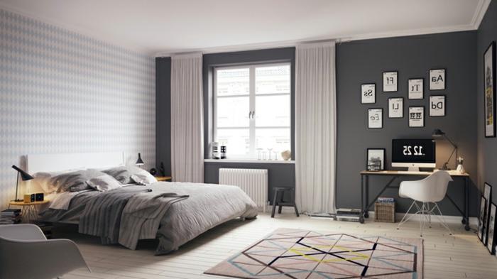 dormitorio matrimonial con paredes en gris oscuro, cama con cabecera en blanco y alfombra de figuras geométricas