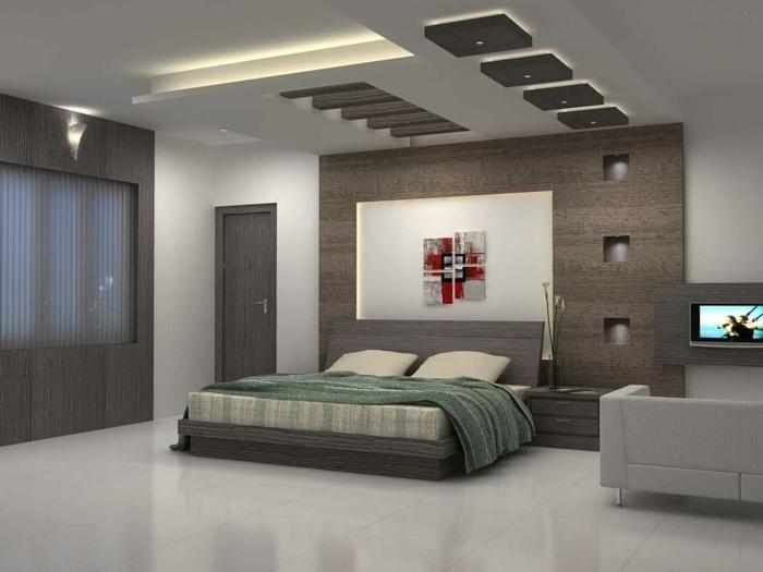 como pintar una habitacion, cama con encimera de madera con manta en verde con suelo de azulejos y sofá