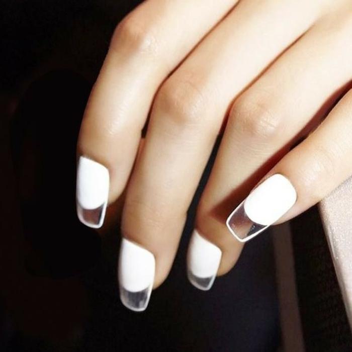 extravagante propuesta decorado de uñas, uñas artificiales en blanco con puntas transparentas